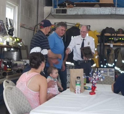 Chief Peterson with Selectmen Anderson and Bell